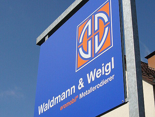 Logo Waldmann & Weigl before changing its name to HandlingTech eromobil.